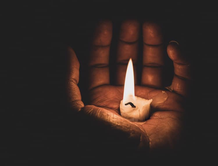 This image is a candle almost at its end, being held in a hand, depicting how desperate we can feel in 2020 when trying to trust God.